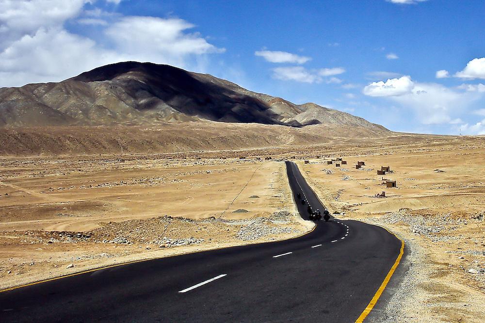 The bike riders on Leh - Kargil Road. Magnetic hill Road.