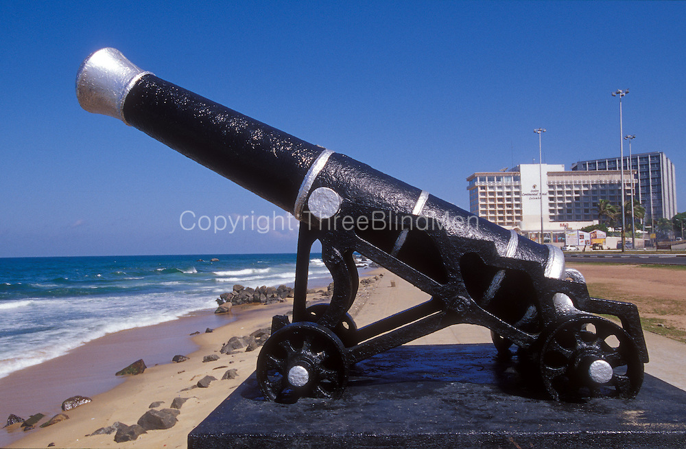 Old canon on the sea front of Colombo City. In the background, the Continental Hotel and Central Bank..Looking north.