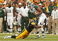 October 6 2013: Iowa Hawkeyes defensive back B.J. Lowery (19) hits Michigan State Spartans wide receiver Bennie Fowler (13) after a catch during the second half of the NCAA football game between the Michigan State Spartans and the Iowa Hawkeyes at Kinnick Stadium in Iowa City, Iowa on October 6, 2013. Michigan State defeated Iowa 26-14.