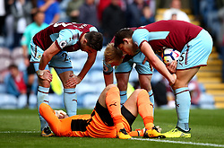 James Tarkowski, James Tarkowski and Stephen Ward of Burnley check on teammate Thomas Heaton after the goalkeeper picks up an injury - Mandatory by-line: Robbie Stephenson/JMP - 10/09/2017 - FOOTBALL - Turf Moor - Burnley, England - Burnley v Crystal Palace - Premier League