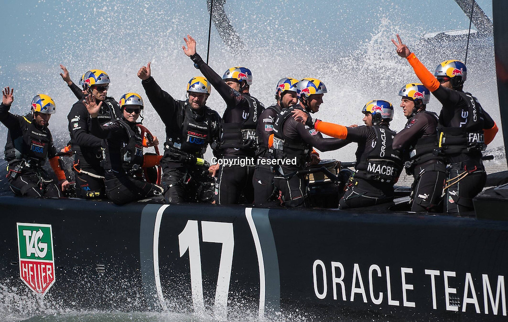 24.09.2013 San Francisco, USA. Oracle Team USA in action against Emirates Team New Zealand during the America's Cup Finals. America celebrate.