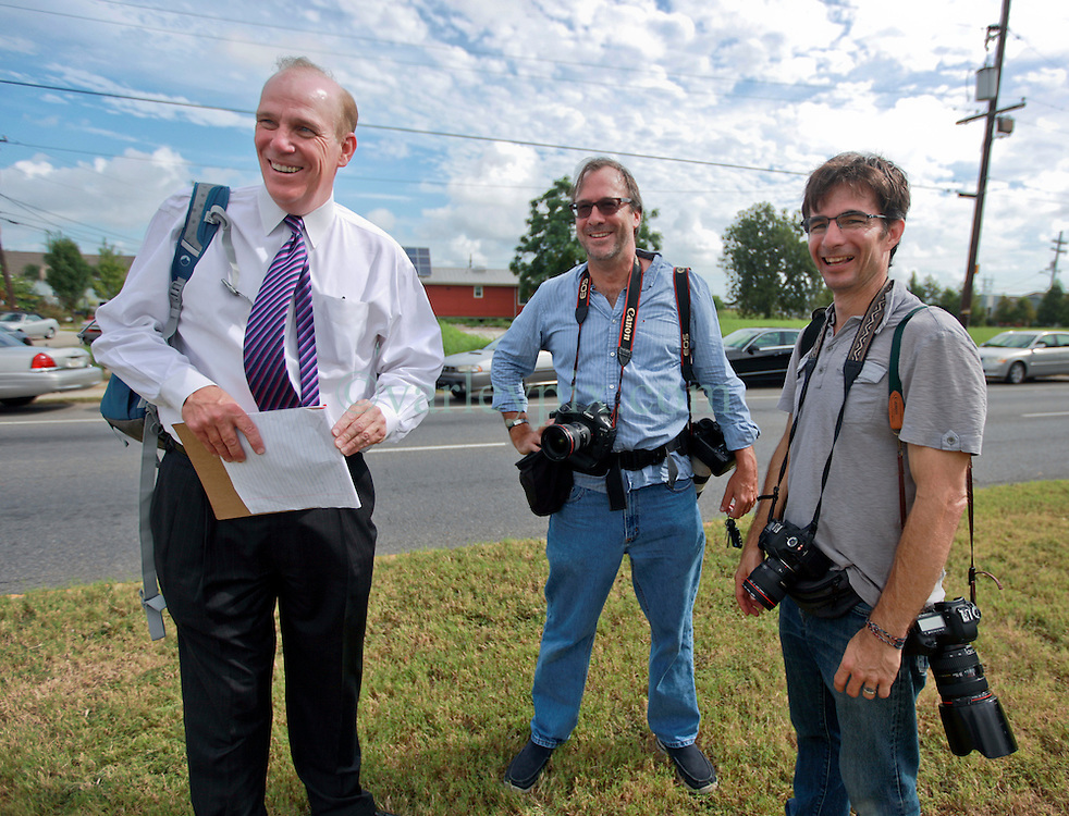 29 August 2014. Lower 9th Ward, New Orleans, Louisiana.<br /> Hurricane Katrina memorial 9 years later. <br /> Newsmen L/R; John Snell, Gerald Herbert and Tyrone Turner. <br /> Photo; Charlie Varley/varleypix.com