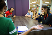 Rancho Middle School seventh grade teachers, from left to right, Pennie Perkins, science (foreground), Roger Mupas, social studies, Carolyn Kamp, math, Lynn Romano, english, and Bianca Laurel, resource teacher, talk about the benefits of the new Student Learning Lab with media at Rancho Middle School in Milpitas, California, on September 16, 2013. (Stan Olszewski/SOSKIphoto)