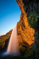 Seljalandsfoss waterfall at sunset, South Iceland.