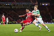Aberdeen defender Shaleum Logan (#2) shields the ball from Celtic midfielder Stuart Armstrong (#14) during the Scottish Cup final match between Aberdeen and Celtic at Hampden Park, Glasgow, United Kingdom on 27 November 2016. Photo by Craig Doyle.