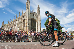 Image ©Licensed to i-Images Picture Agency. 07/07/2014. Cambridge, United Kingdom. Richie Porte has a mechanical problem at Kings College. Riders pass Kings College Cambridge. Picture by Terry Harris / i-Images