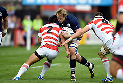 Jonny Gray of Scotland takes on Shota Horie of Japan - Mandatory byline: Patrick Khachfe/JMP - 07966 386802 - 23/09/2015 - RUGBY UNION - Kingsholm Stadium - Gloucester, England - Scotland v Japan - Rugby World Cup 2015 Pool B.