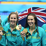 Swimming - Olympics: Day 1 The Australian team of  Cate Campbell, Bronte Campbell, Brittany Elmslie and Emma McKeon, at the medal presentation for winning the gold medal in world record time in the Women's 4 x 100m Freestyle Relay Final during the swimming competition at the Olympic Aquatics Stadium August 6, 2016 in Rio de Janeiro, Brazil. (Photo by Tim Clayton/Corbis via Getty Images)