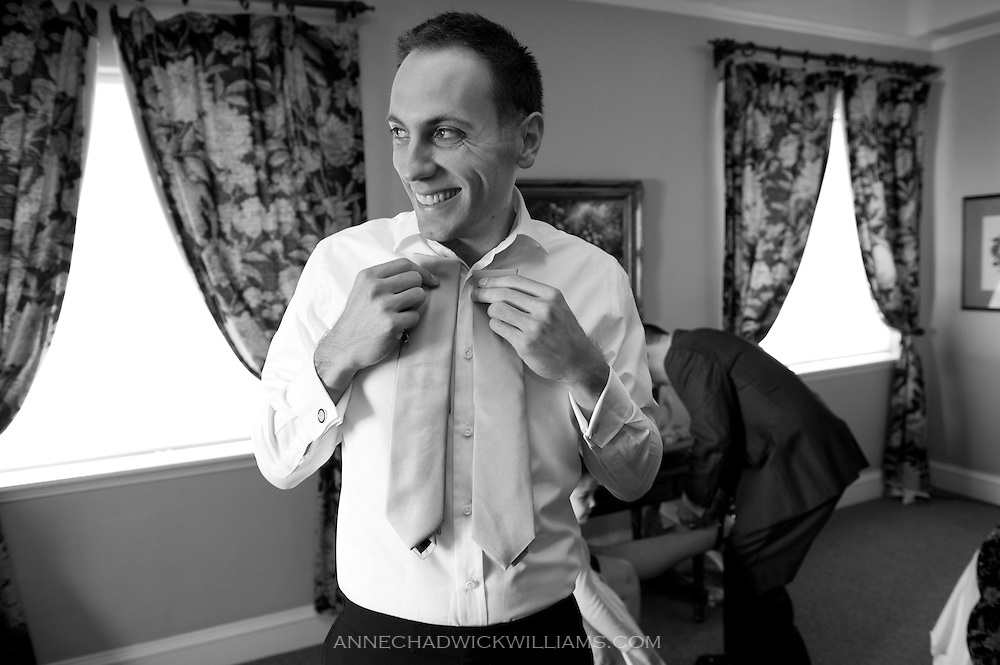 A groom picks his tie before his wedding at the Berkeley City Club.