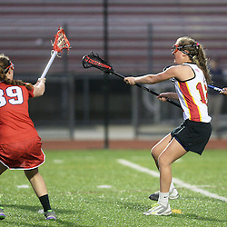 Staff photo by Tom Kelly IV<br /> Haverford's Jessica Lyons (12) shoots and scores her 100th goal of her career at Haverford during Friday nights game versus Plymouth Whitemarsh.