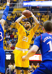 Jan 24, 2017; Morgantown, WV, USA; West Virginia Mountaineers forward Esa Ahmad (23) shoots a jumper during the second half against the Kansas Jayhawks at WVU Coliseum. Mandatory Credit: Ben Queen-USA TODAY Sports