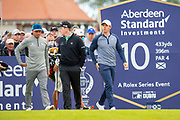 Rickie Fowler (USA)(left), Robert MacIntyre (SCO)(centre) and Rory McIlroy (NIR) head off down the fairway after hitting their opening tee shots during the second round of the Aberdeen Standard Investments Scottish Open at The Renaissance Club, North Berwick, Scotland on 12 July 2019.