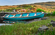 A row boat on the river near Ballynahinch Castle Hotel in Connemara Co. Galway, Ireland