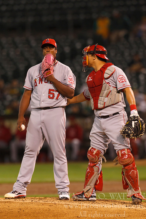 September 13, 2011; Oakland, CA, USA;  Los Angeles Angels catcher Hank Conger (right) talks to starting pitcher Jerome Williams (57) on the pitchers mound during the third inning against the Oakland Athletics at O.co Coliseum.