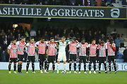Brentford players during the two minutes Armistice silence before the EFL Sky Bet Championship match between Queens Park Rangers and Brentford at the Loftus Road Stadium, London, England on 10 November 2018.