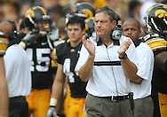 September 3, 2011: Iowa Hawkeyes head coach Kirk Ferentz applauds his team during the first half of the game between the Tennessee Tech Golden Eagles and the Iowa Hawkeyes at Kinnick Stadium in Iowa City, Iowa on Saturday, September 3, 2011. Iowa defeated Tennessee Tech 34-7 in a game stopped at one point due to lightning and rain.