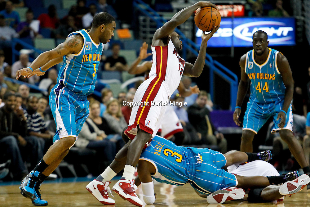 October 13, 2010; New Orleans, LA, USA; Miami Heat point guard Patrick Beverley (12) collides with New Orleans Hornets point guard Chris Paul (3) during the second half of a preseason game at the New Orleans Arena. The Hornets defeated the Heat 90-76. Mandatory Credit: Derick E. Hingle