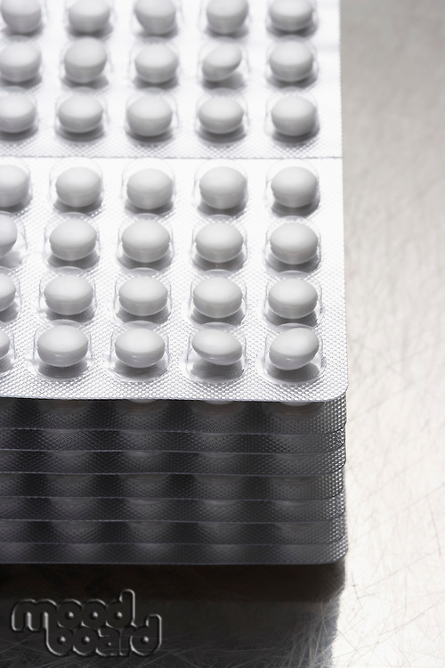 Stack of pills in packaging close-up
