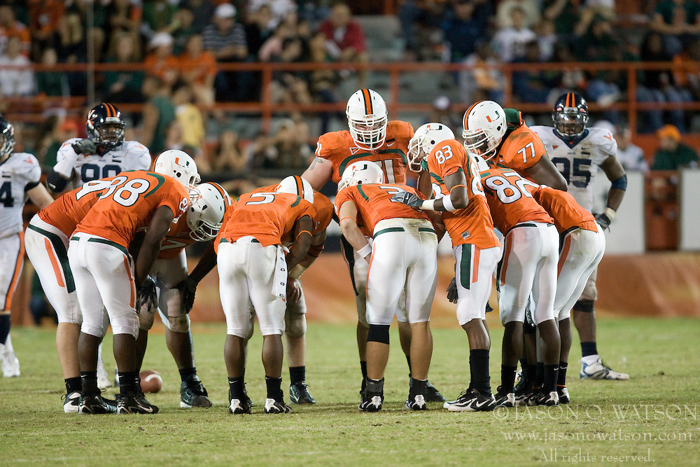 Miami offensive huddle..The #19 Virginia Cavaliers defeated the Miami Hurricanes 48-0 at the Orange Bowl in Miami, Florida on November 10, 2007.  The game was the final game played in the Orange Bowl.