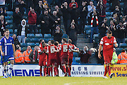 Gianvito Plasmati celebrates with team mates after scoring the opening goal during the Sky Bet League 1 match between Gillingham and Leyton Orient at the MEMS Priestfield Stadium, Gillingham, England on 15 November 2014.