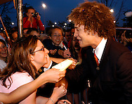 """Justin Guarini, American Idol runner-up and Doylestown native greets fans at an advance screening of the film """"From Justin to Kelly"""" after being honored at te Regal Warrington Crossing 22 Theater June 13, 2003 in Warrington, Pennsylvania. Guarini stars in the Twentieth Century Fox film along with American Idol Kelly Clarkson. (Photo by William Thomas Cain/photodx.com)"""