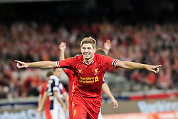© Licensed to London News Pictures. 24/7/2013. Steven Gerrard celebrates after scoring  during the Melbourne Victory Vs Liverpool F.C at the Melbourne Cricket Ground, Melbourne, Australia. Photo credit : Asanka Brendon Ratnayake/LNP