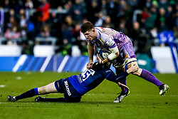 Dave Ewers of Exeter Chiefs is tackled by Simon Hammersley of Sale Sharks - Mandatory by-line: Robbie Stephenson/JMP - 08/12/2019 - RUGBY - AJ Bell Stadium - Manchester, England - Sale Sharks v Exeter Chiefs - Heineken Champions Cup
