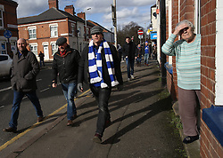 04 March 2017 Leicester : Premier League Football ; Leicester City v Hull City :<br /> an elderly lady looks out from the doorstep of her house as the fans walk close to the old Filbert Street stadium, on their way to the King Power.<br /> Photo: Mark Leech