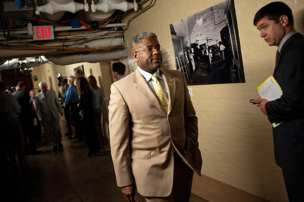 Rep. ALLEN WEST (R-FL) leaves a House Conference meeting at the U.S. Capitol on Wednesday as they continue negotiations on raising the debt ceiling.