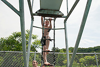 Dylan Sullivan climbs the ladder to the high dive during the 70th Anniversary celebration of the Kiwanis Pool in St. Johnsbury Vermont.  Karen Bobotas / for Kiwanis International
