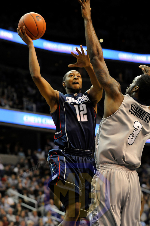 12 January 2008:   University of Connecticut Huskies guard A. J. Price (12) scores 2 of his 17 points against Georgetown University Hoyas forward DaJuan Summers (3) in the second half at the Verizon Center in Washington, D.C.  The Georgetown Hoyas defeated the Connecticut Huskies 72-69.