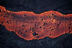 2018 05 24 - Pahoa, Hawaii, USA:  A 50-60 foot wide river of lava makes its way to the sea near Malama Flats, on the island of Hawaii.<br />Photo: ZUMA Press/Bruce Omori/Paradise Helicopters