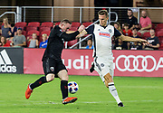 WASHINGTON, DC - AUGUST 29: D.C. United forward Wayne Rooney (9) goes for a loose ball with Philadelphia Union defender Jack Elliott (3) during a MLS match between D.C United and the Philadelphia Union on August 29, 2018, at Audi Field, in Washington, DC. <br /> The Philadelphia Union defeated DC United 2-0.<br /> (Photo by Tony Quinn/Icon Sportswire)