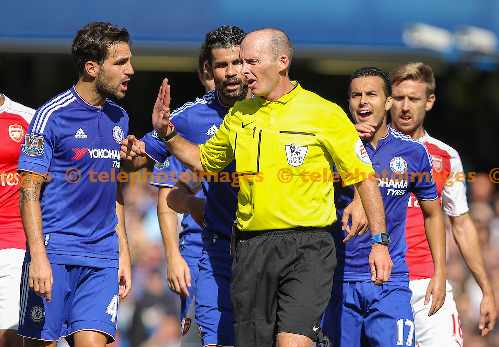 Chelsea players surround the referee during the Barclays Premier League match between Chelsea and Arsenal at Stamford Bridge in London. September 19, 2015.<br /> Arron Gent / Telephoto Images<br /> +44 7967 642437