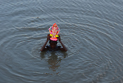 September 5, 2017 - Allahabad, India - A young indian hindu devotee immerse the idol of Elephant headed hindu God Ganesha after worship making in the end of the 10 day long ganesh Chaturthi festival in a water pond near ganges River, in Allahabad on September 5,2017. (Credit Image: © Ritesh Shukla/NurPhoto via ZUMA Press)