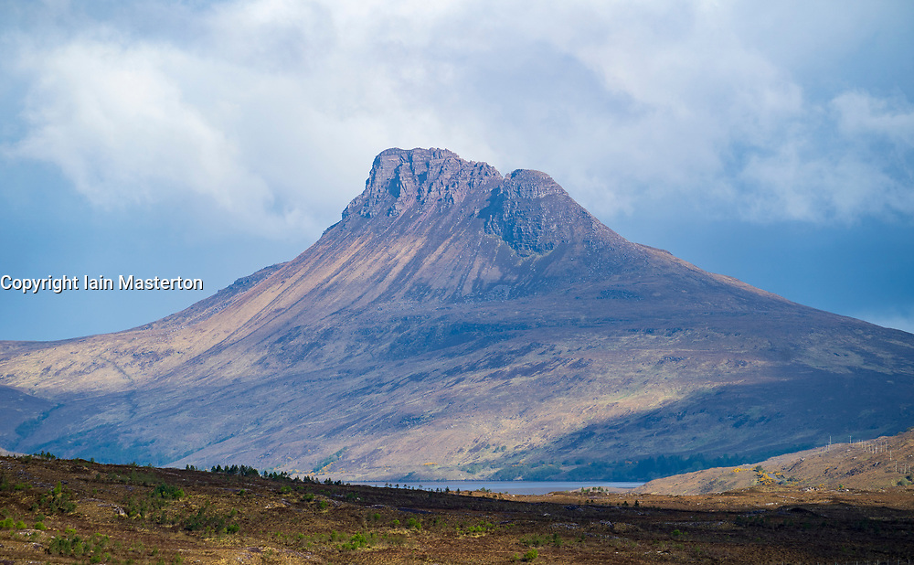 View of Stac Pollaidh mountain in Assynt on the North Coast 500 scenic driving route in northern Scotland, UK