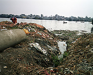 "The Buriganga river is now one of the most polluted rivers in Bangladesh due to dumping of industrial and human waste. A World Bank study said four major rivers near Dhaka -- the Buriganga, Shitalakhya, Turag and Balu -- receive 1.5 million cubic metres of waste water every day from 7,000 industrial units in surrounding areas and another 0.5 million cubic meters from other sources. ""The pollutants have eaten up all oxygen in the Buriganga and we call it biologically dead. It is like a septic tank,"" said Khawaja Minnatullah, a World Bank specialist on environment and water management.""There is no fish or aquatic life in this river apart from zero oxygen survival kind of organisms."" Chemicals such as cadmium and chromium, and other elements such as mercury carried by the industrial waste are also creeping into the ground water, posing a serious threat to public health.."