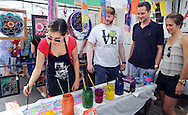 From left, Monica Dickson, Chris Dickson of Blue Bell, Mike Croasdale and Nicole Mahaffey of North Wales watch as Monica paints during Doylestown Arts Fest  September 10, 2016 in Doylestown, Pennsylvania.  (Photo by William Thomas Cain)