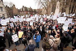 © Licensed to London News Pictures. 07/03/2014. Westminster, London, UK. Crowd of protestors, including lawyers on a half cut walkout, gather on Old Palace Yard to protest at government-proposed legal aid cuts as part of the Save UK Justice campaign. Photo credit : David Tett/LNP