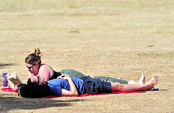 &copy; Licensed to London News Pictures. 01/08/2018<br /> Greenwich, UK. A man and a woman enjoy the sunshine while lying down on Greenwich Park, London, as a heatwave is set to return to the UK. Photo credit: Grant Falvey/LNP