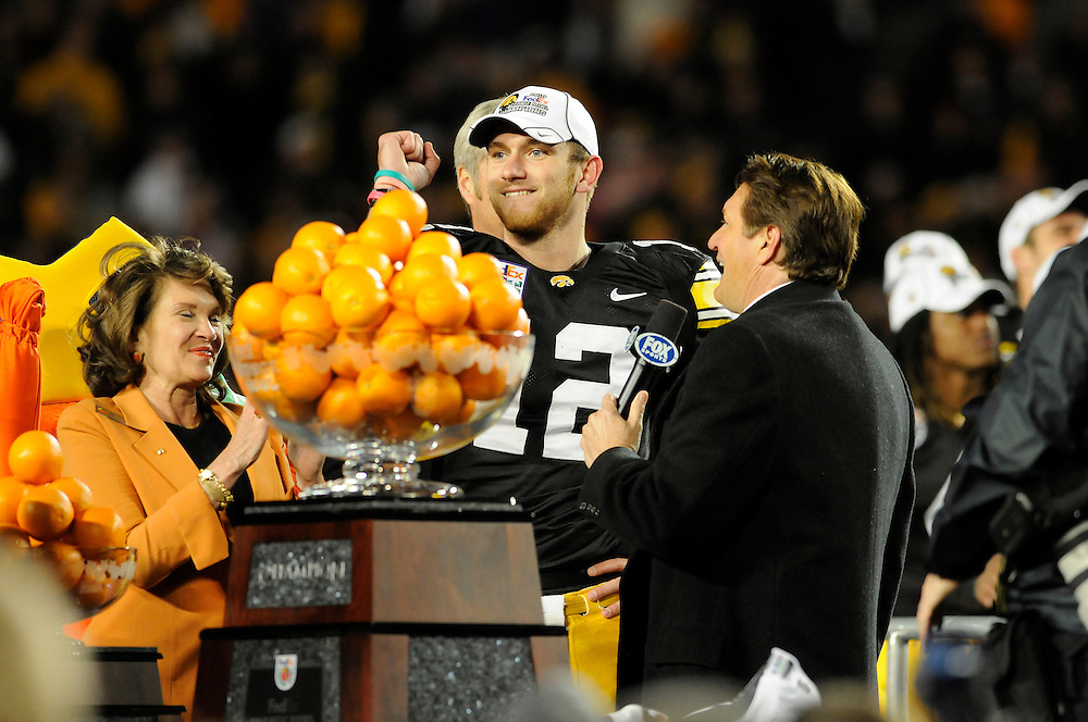 January 5, 2010: Quarterback Ricky Stanzi poses with the Orange Bowl Trophy while talking to Fox Sports' Chris Myers after the NCAA football game between the Georgia Tech Yellow Jackets and the Iowa Hawkeyes in the Orange Bowl at LandShark Stadium in Miami Gardens, Florida. The Hawkeyes defeated the Yellow Jackets 24-14.