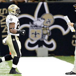 August 12, 2011; New Orleans, LA, USA; New Orleans Saints head coach Sean Payton and running back Mark Ingram (28) during the first half of a preseason game against the San Francisco 49ers at the Louisiana Superdome. Mandatory Credit: Derick E. Hingle