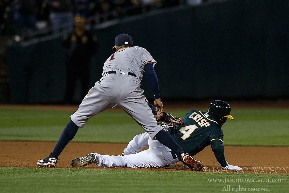 OAKLAND, CA - JULY 19:  Coco Crisp #4 of the Oakland Athletics is tagged out between second and third base by Carlos Correa #1 of the Houston Astros during the ninth inning at the Oakland Coliseum on July 19, 2016 in Oakland, California. The Oakland Athletics defeated the Houston Astros 4-3 in 10 innings.  (Photo by Jason O. Watson/Getty Images) *** Local Caption *** Coco Crisp; Carlos Correa