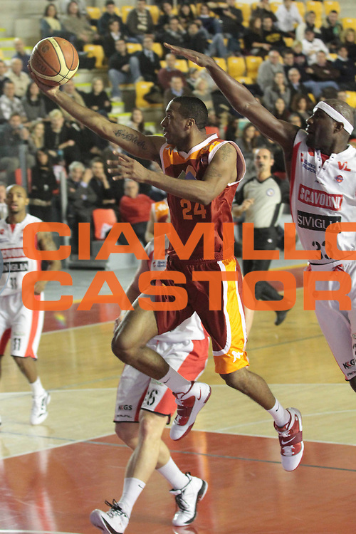 DESCRIZIONE : Roma Campionato Lega A 2011-12 Acea Roma Scavolini Siviglia Pesaro<br /> GIOCATORE : Clay Tucker<br /> CATEGORIA : sottomano<br /> SQUADRA : Acea Roma<br /> EVENTO : Campionato Lega A 2011-2012<br /> GARA : Acea Roma Scavolini Siviglia Pesaro<br /> DATA : 11/01/2012<br /> SPORT : Pallacanestro<br /> AUTORE : Agenzia Ciamillo-Castoria/M. Simoni<br /> Galleria : Lega Basket A 2011-2012<br /> Fotonotizia : Roma Campionato Lega A 2011-12 Acea Roma Scavolini Siviglia Pesaro<br /> Predefinita :