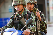 "Sept. 25, 2009 -- PATTANI, THAILAND: Thai soldiers patrol downtown Pattani, Thailand on motorcycles. Thailand's three southern most provinces; Yala, Pattani and Narathiwat are often called ""restive"" and a decades long Muslim insurgency has gained traction recently. Nearly 4,000 people have been killed since 2004. The three southern provinces are under emergency control and there are more than 60,000 Thai military, police and paramilitary militia forces trying to keep the peace battling insurgents who favor car bombs and assassination.  Photo by Jack Kurtz / ZUMA Press"
