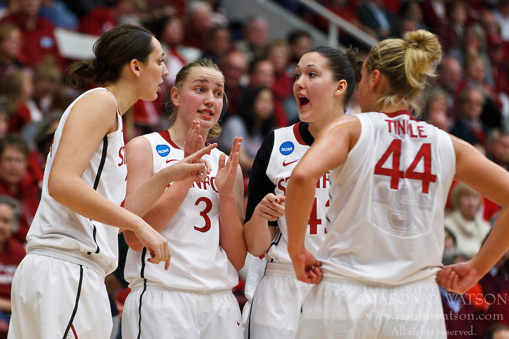 March 21, 2011; Stanford, CA, USA; Stanford Cardinal forward Ashley Cimino (left), forward Mikaela Ruef (3), forward/center Sarah Boothe (second from right) and forward Joslyn Tinkle (44) huddle during a time out against the St. John's Red Storm during the second half of the second round of the 2011 NCAA women's basketball tournament at Maples Pavilion. Stanford defeated St. John's 75-49.