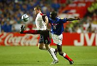 England v France - Estadio de Luz, Lisbon - 13th June 2004<br />England's Wayne Rooney gets the better of France's Lilian Thuram<br />Photo: Jed Leicester/Sporting Pictures<br />© Sporting Pictures (UK) Ltd<br />www.sportingpictures.com<br />Tel: +44 (0)20 7405 4500<br />Fax: +44 (0)20 7831 7991