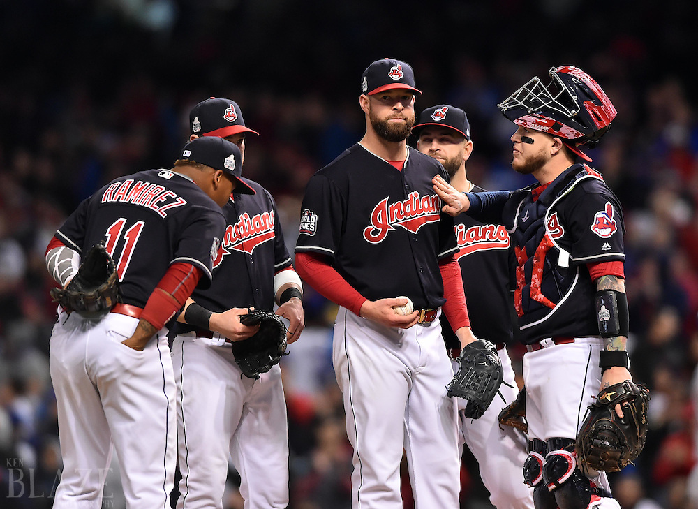 Oct 25, 2016; Cleveland, OH, USA; Cleveland Indians starting pitcher Corey Kluber (middle) is congratulated by teammates as he waits to be relieved in the 7th inning against the Chicago Cubs in game one of the 2016 World Series at Progressive Field. Mandatory Credit: Ken Blaze-USA TODAY Sports