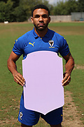 AFC Wimbledon striker Andy Barcham (17) holding Fifa sign during the AFC Wimbledon 2018/19 official photocall at the Kings Sports Ground, New Malden, United Kingdom on 31 July 2018. Picture by Matthew Redman.