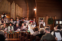 """Judy Buswell leads the chorus and audience in """"Singing the Old Time Religion"""" at the Methodist Advent Christian Church in Lakeport on Sunday afternoon.  (Karen Bobotas/for the Laconia Daily Sun)"""